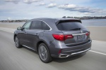 2019 Acura MDX Sport Hybrid in Modern Steel Metallic - Driving Rear Left View