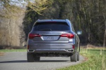 2019 Acura MDX Sport Hybrid in Modern Steel Metallic - Driving Rear View