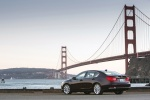 2014 Acura RLX Sport Hybrid in Pomegranate Pearl - Static Rear Left Three-quarter View