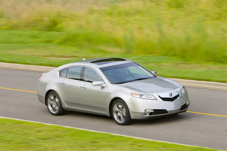 Driving 2010 Acura TL SH-AWD in Palladium Metallic from a front right three-quarter view