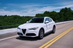 2018 Alfa Romeo Stelvio Ti Lusso AWD in Trofeo White Tri-Coat - Driving Front Left Three-quarter View
