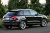 2016 Audi Q3 2.0T quattro in Brilliant Black from a rear right three-quarter view