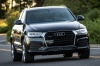 Driving 2016 Audi Q3 2.0T quattro in Brilliant Black from a front right view