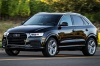 Driving 2016 Audi Q3 2.0T quattro in Brilliant Black from a front left three-quarter view