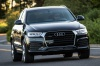 Driving 2017 Audi Q3 2.0T quattro in Brilliant Black from a front right view