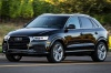 Driving 2017 Audi Q3 2.0T quattro in Brilliant Black from a front left three-quarter view