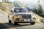 2018 Bentley Bentayga in Amber Metallic - Driving Front Right View