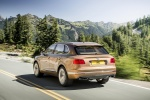 2018 Bentley Bentayga in Amber Metallic - Driving Rear Left Three-quarter View