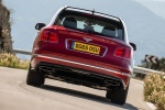 2018 Bentley Bentayga in Rubino Red Metallic - Driving Rear View