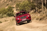 2018 Bentley Bentayga in Rubino Red Metallic - Driving Frontal View