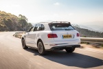 2018 Bentley Bentayga in Glacier White - Driving Rear Left Three-quarter View