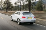 2018 Bentley Bentayga in Glacier White - Driving Rear Left View