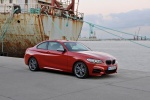 2015 BMW M235i Coupe in Melbourne Red Metallic - Static Front Right Three-quarter View