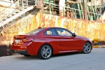 2016 BMW M235i Coupe in Melbourne Red Metallic - Static Rear Right Three-quarter View