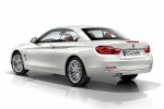 2014 BMW 428i Convertible with top closed in Mineral White Metallic - Static Rear Left Three-quarter View