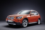 2013 BMW X1 in Valencia Orange Metallic - Static Front Left Three-quarter View