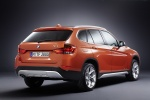 2014 BMW X1 in Valencia Orange Metallic - Static Rear Right Three-quarter View