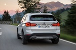 2019 BMW X1 xDrive28i in Alpine White - Driving Rear View