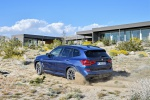 2019 BMW X3 M40i in Phytonic Blue Metallic - Driving Rear Left Three-quarter View