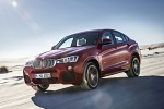 2018 BMW X4 in Melbourne Red Metallic - Driving Front Left Three-quarter View