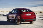 2018 BMW X4 in Melbourne Red Metallic - Driving Rear Left View
