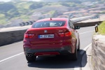 2018 BMW X4 in Melbourne Red Metallic - Driving Rear View