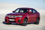 2018 BMW X4 in Melbourne Red Metallic - Static Front Left Three-quarter View