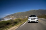 2018 BMW X4 M40i in Mineral White Metallic - Driving Frontal View
