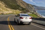 2018 BMW X4 M40i in Mineral White Metallic - Driving Rear View