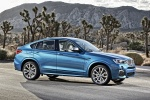 2018 BMW X4 M40i in Long Beach Blue Metallic - Static Front Right Three-quarter View