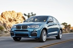 2018 BMW X4 M40i in Long Beach Blue Metallic - Driving Front Left Three-quarter View