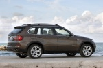 2013 BMW X5 xDrive50i in Sparkling Bronze Metallic - Static Rear Right Three-quarter View