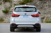 2016 BMW X5 xDrive50i in Alpine White from a rear view