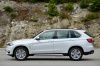 2016 BMW X5 xDrive50i in Alpine White from a side view