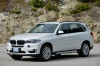 2017 BMW X5 xDrive50i in Alpine White from a front left three-quarter view