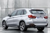 2017 BMW X5 xDrive40e in Glacier Silver Metallic from a rear left view
