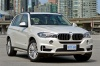 2017 BMW X5 xDrive50i in Alpine White from a front right view