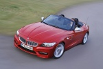 2011 BMW Z4 sdrive35is in Crimson Red - Driving Front Left Three-quarter Top View
