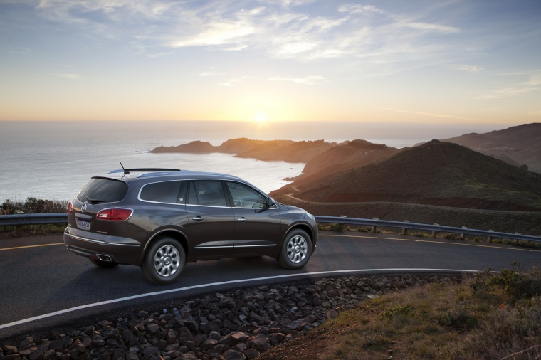 Driving 2016 Buick Enclave from a rear right three-quarter view