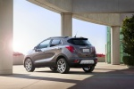 2015 Buick Encore in Cocoa Silver Metallic - Static Rear Left Three-quarter View