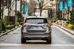 2019 Buick Envision AWD in Satin Steel Metallic - Driving Rear View