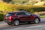2019 Cadillac XT5 AWD in Red - Driving Rear Right Three-quarter View