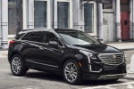 2019 Cadillac XT5 AWD in Dark Granite Metallic - Driving Front Right Three-quarter View