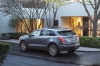 2020 Cadillac XT5 Sport AWD in Satin Steel Metallic from a rear left view