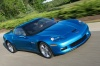 Driving 2010 Chevrolet Corvette Grand Sport Coupe in Jetstream Blue Metallic Tintcoat from a front right three-quarter view