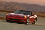 2010 Chevrolet Corvette Coupe in Crystal Red Metallic Tintcoat - Driving Front Left View