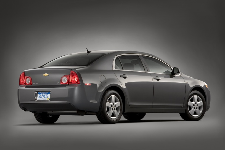 2010 Chevrolet Malibu LS in Taupe Gray Metallic from a rear right three-quarter view