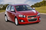 2012 Chevrolet Sonic Hatchback in Victory Red / Summit White - Driving Front Right View