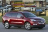 2011 Chevrolet Traverse LTZ in Red Jewel Tintcoat from a front right view