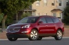2011 Chevrolet Traverse LTZ in Red Jewel Tintcoat from a front left three-quarter view